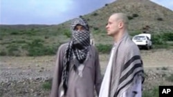 FILE: Qatar has extended travel restrictions for five Taliban men released last year by the United States in exchange for captured U.S. Army Sgt. Bowe Bergdahl, shown at right in undated video image from Voice of Jihad website.
