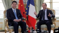 法國總統奧朗德與中國國家主席習近平於2014年3月26日會晤資料照。