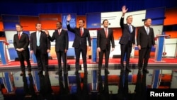 Republican presidential candidates Sen. Rand Paul, Gov. Chris Christie, Dr. Ben Carson, Sen. Ted Cruz, Sen. Marco Rubio, former Gov. Jeb Bush and Gov. John Kasich stand onstage at the start of the Republican presidential debate in Des Moines, Iowa Jan. 28