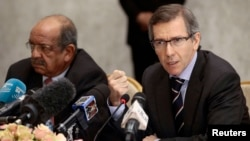 FILE - Bernardino Leon, right, the U.N. special envoy for a Libya, addresses Libyan political leaders and rivals in Algiers; at left is Algeria's minister of African and Maghreb affairs, Abdelkader Messahel, March 10, 2015.