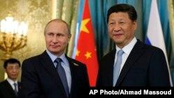 中國國家主席習近與俄羅斯總統普京。(資料照)