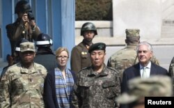 U.S. Secretary of State Rex Tillerson (right) stands with South Korean Deputy Commander of the Combined Force Command Gen. Leem Ho-young (second right) as two North Korean soldiers look at the south side at the border village of Panmunjom, March 17, 2017. Also pictured: Command Sgt. Maj. Steven L. Payton (left) of the United Nations Command, Combined Forces Command and United States Forces Korea and U.S. Secretary of State's Chief of Staff Margaret Peterlin.