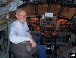 Volunteer Bob Hood in the Comet's restored cockpit.