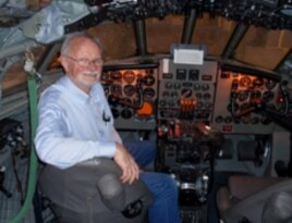 Volunteer Bob Hood in the Comet's restored cockpit.