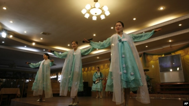 Waitresses not only serve food, they also put on musical performance for the customers in the Pyongyang Restaurant.