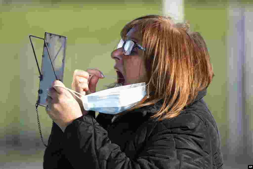A member of the public swabs herself on the first day of the pilot scheme of mass testing in Liverpool. Liverpool is the pilot project for possible weekly testing of the entire population, covering up to 10 million people across England a day.
