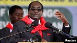 FILE: Zimbabwe President Robert Mugabe addresses people gathered for his 91st birthday celebration in Victoria Falls, Feb. 28, 2015.