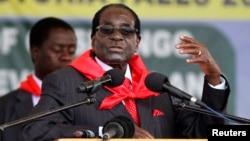 FILE: Zimbabwe President Robert Mugabe addresses people gathered for his 91st birthday celebration in Victoria Falls, Feb. 28, 2015.