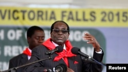 FILE - Zimbabwe President Robert Mugabe addresses people gathered for his 91st birthday celebration in Victoria Falls, Feb. 28, 2015.
