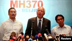 马来西亚总理纳吉布•拉扎克3月15日举行记者会