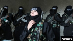 Um Jaafar, a woman fighter in the Free Syrian Army, with other women undergoing military training in Aleppo.
