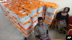 FILE - Polling station workers are seen guarding ballot boxes following presidential elections in Lusaka, Zambia, Jan. 21, 2015.