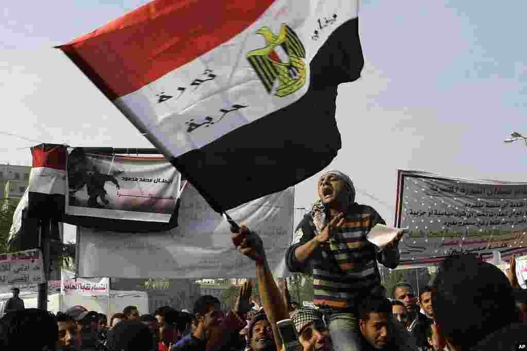 Egyptian protesters shout anti-military ruling council slogans during a protest at Tahrir Square, the focal point of Egyptian uprising, in Cairo, November 27, 2011. (AP)