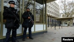 FILE - Police officers are seen patrolling outside the U.S. Embassy in London in a Dec. 9, 2014, photo.