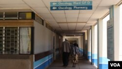 FILE - A patient accompanied by a visitor is seen walking inside Kenyatta National Hospital in Nairobi, Kenya. According to the country's Ministry of Health, every year about 41,000 new cases are diagnosed in Kenya every year. (VOA / R. Ombuor)
