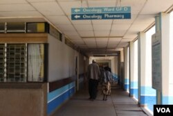 FILE - A patient accompanied by a visitor is seen walking inside Kenyatta National Hospital in Nairobi, Kenya.