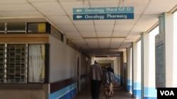 FILE - A patient accompanied by a visitor is seen walking inside Kenyatta National Hospital in Nairobi, Kenya.