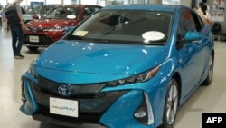 Toyota Motor's latest cars are exhibited at their showroom in Tokyo on Aug. 3, 2018. The Japanese car giant on Aug. 3, 2018, said its first quarter net profit rose 7.2 percent.