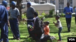 FILE: Sten Zvorwadza attempting to handover flowers to police recently.