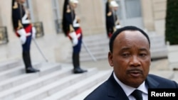 FILE - Niger's president, Mahamadou Issoufou, is seen during a May 2013 visit to France.
