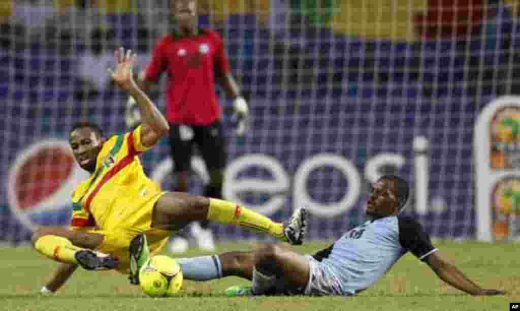 Mali's Seydou Keita (12) is tackled by Botswana's Mogogi Gabonamong during their final African Cup of Nations Group D soccer match at the Stade De L'Amitie Stadium in Libreville February 1, 2012.