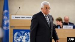 Presiden Palestina Mahmud Abbas menyampaikan pidato di hadapan Dewan Hak Asasi PBB di Jenewa, Swiss, 27 Februari 2017. (AFP PHOTO / Fabrice COFFRINI)