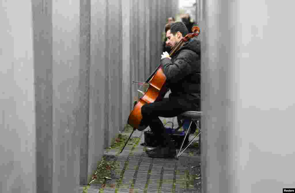 "Slovenian Luka Sulic, a member of the Cellisten-Duo ""2Cellos"", plays cello at the Holocaust Memorial in Berlin, Germany."