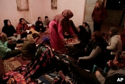 In this March 30, 2019 photo, Umm Yasser offers tea to during a women's only circle of tourists and Bedouin from the Hamada tribe, at her home in Wadi Sahw, Abu Zenima, in South Sinai, Egypt. (AP Photo/Nariman El-Mofty)