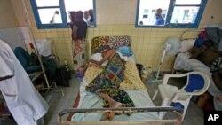 Paciente diagnosticada com SIDA internado no hospital de Kinshasa.