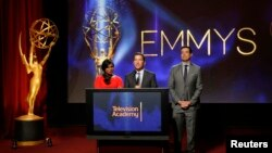 Television Academy Chairman & CEO Bruce Rosenblum (C), actress Mindy Kaling (L) and television host Carson Daly (R) stand together during the nominations announcement for the 66th Primetime Emmy Awards in North Hollywood, California, July 10, 2014.