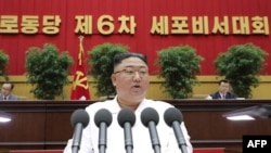 This picture taken on April 8, 2021 and released from North Korea's official Korean Central News Agency (KCNA) on April 9, 2021 shows North Korean leader Kim Jong Un delivering a closing address at the Sixth Conference of Cell Secretaries of the Workers'