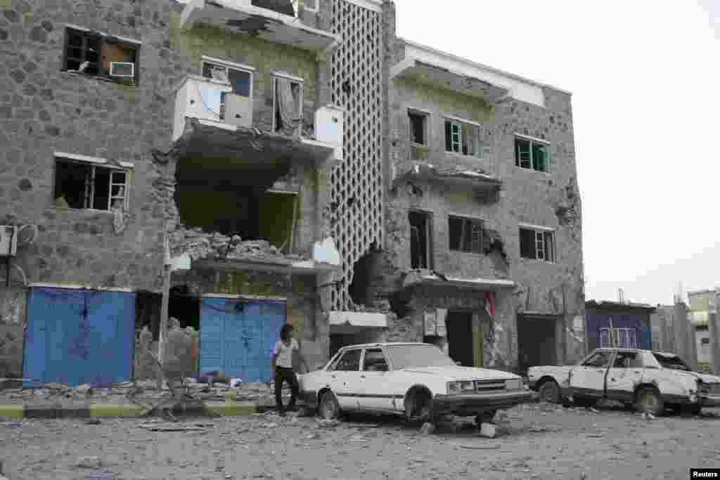 A building damaged during fighting between army forces and al-Qaida-linked militants in the southern Yemeni city of Zinjibar, June 12, 2012.