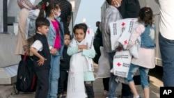 انخلا کے بعد ورجینیا کے علاقے شنٹلی پہنچنے والے چند افغان بچے۔