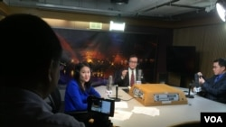 VOA Khmer's Reasey Poch uses an iPhone mounted on a tripod to broadcast live on Facebook, during a simultaneous live radio broadcast with Cambodian opposition leader Sam Rainsy, seated between hosts Kimseng Men (R) and Moryvan Ly (L), Feb. 3, 2016.