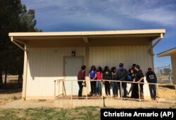 In this April 30, 2015 photo, students line up outside classroom at the Cuyama Valley High School in New Cuyama, California. The school is 60 miles from the nearest city
