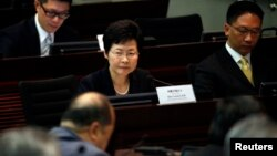 FILE - Hong Kong Chief Secretary Carrie Lam looks on during a meeting on proposing electoral reforms at the Legislative Council in Hong Kong. Carrie Lam and her Hong Kong government colleagues have been facing increased scrutiny in the U.S. capital for their handling of recent political unrest in the autonomous Chinese territory.