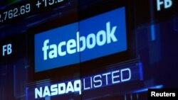 FILE - Monitors displays the Facebook, Inc. stock during morning trading at the NASDAQ Marketsite in New York, NY, U.S., June 4, 2012.