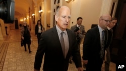 FILE - California Gov. Jerry Brown returns to his office after a meeting in Sacramento, California, April 6, 2017. Brown and the California Legislature are among this year's winners of the Jefferson Muzzles, satiric awards bestowed by a free speech group for what it considers egregious offenses.