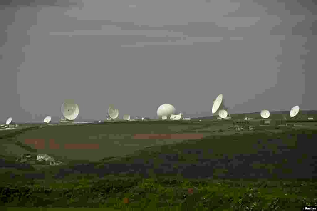 Satellite dishes are seen at Britain's spy agency GCHQ's outpost at Bude, close to where trans-Atlantic fiber-optic cables come ashore in Cornwall, southwest England, June 23, 2013.
