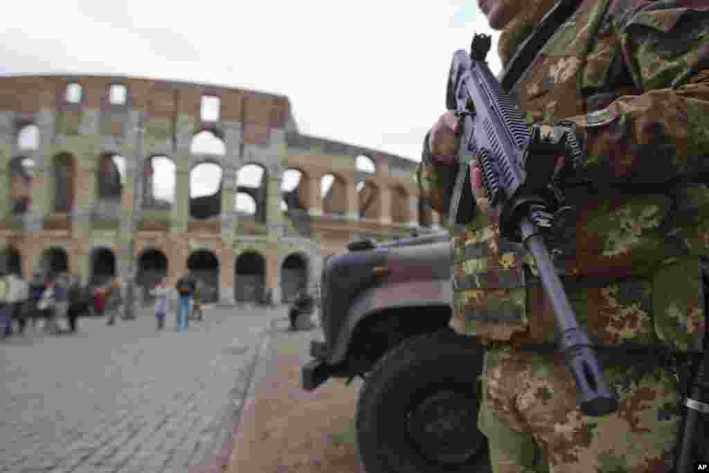 "An Italian soldier patrols near Rome's Colosseum. Milan's cathedral and La Scala opera house, as well as ""general venues"" like churches, synagogues, restaurants, theaters and hotels have been identified as ""potential targets"" in those two cities for terrorist attacks."