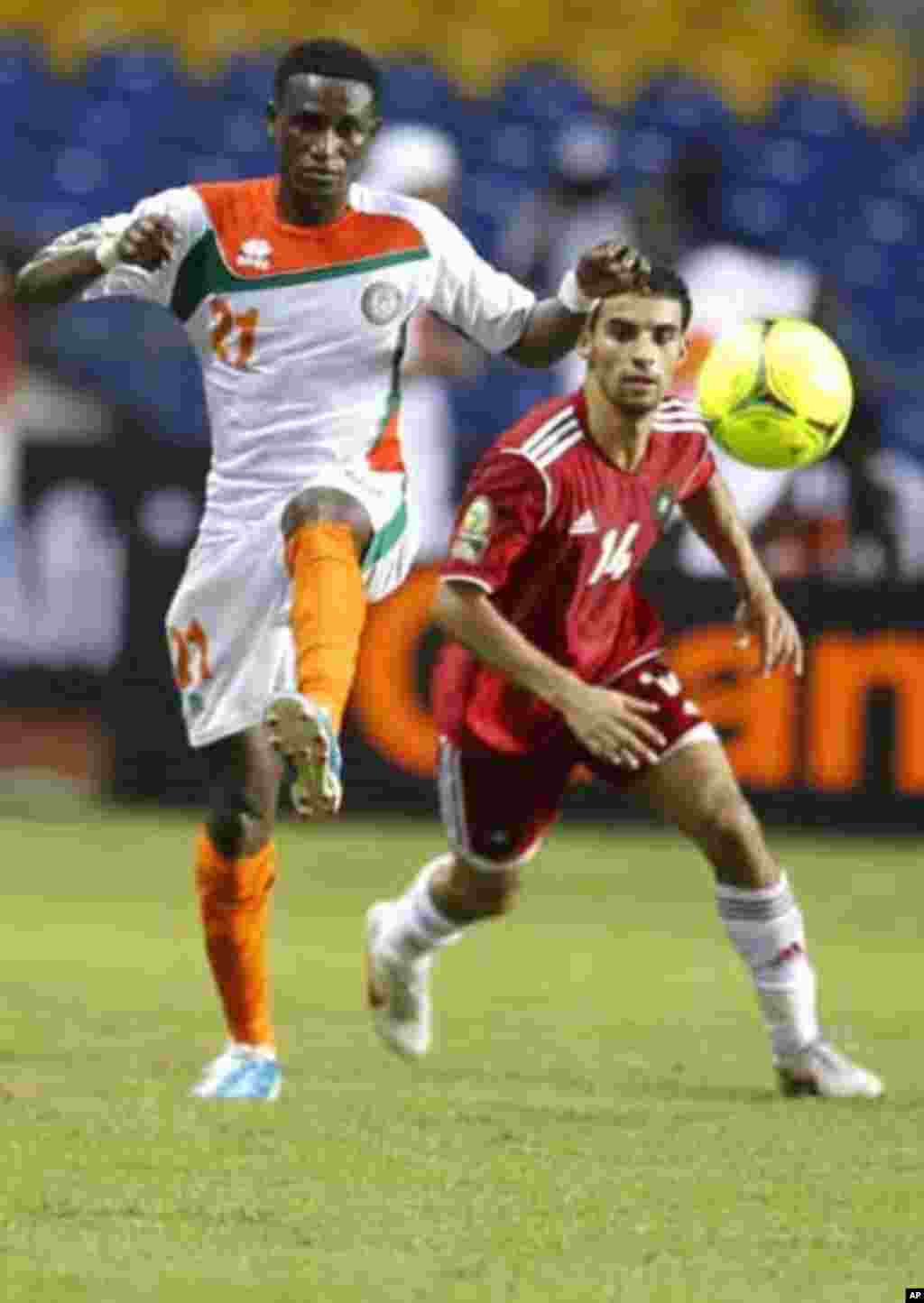 Niger's Seydou Ali Yacouba (21) plays against Morocco's Mbark Boussoufa (14) during their final African Cup of Nations Group C soccer match at the Stade De L'Amitie Stadium in Libreville, Gabon, January 31, 2012.