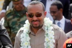 FILE - The new prime minister of Ethiopia, Abiy Ahmed, visits Mogadishu, Somalia, June 16, 2018.
