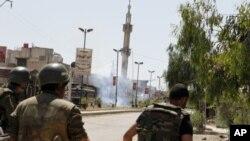Binh sĩ Syria sau 1 vụ nổ gần Damascus, 20/5/2012