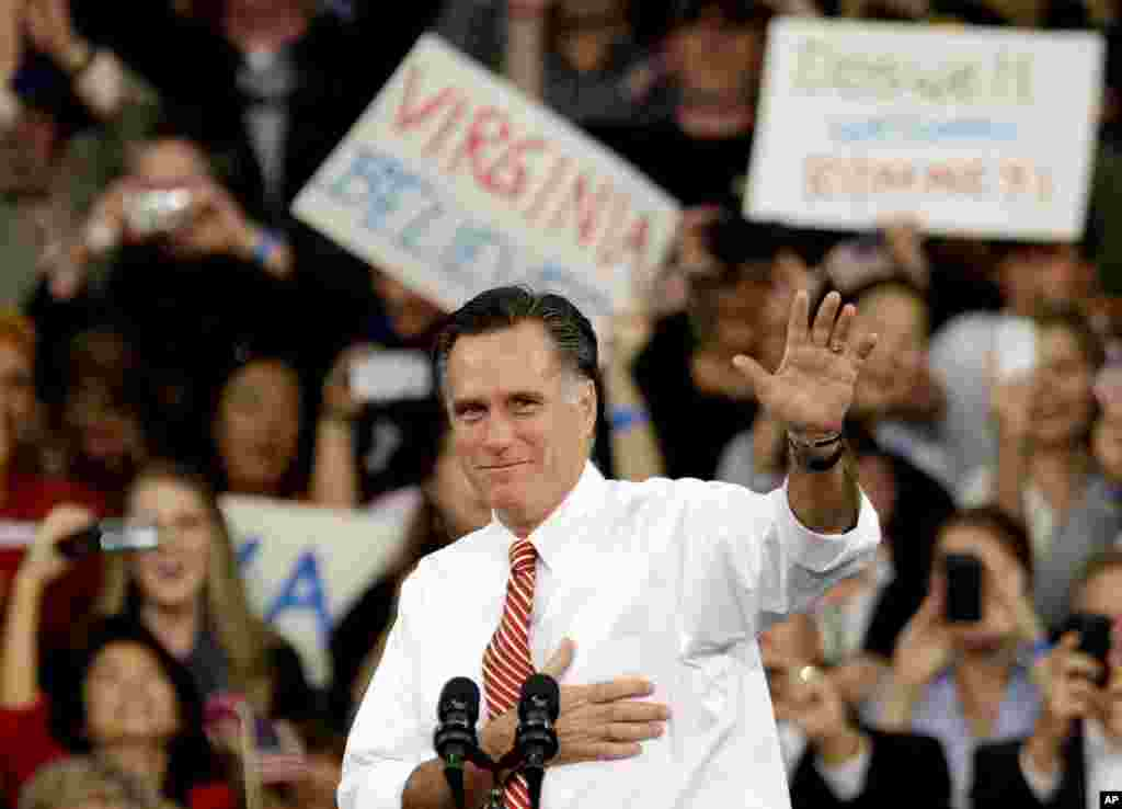 Republican presidential candidate, former Massachusetts Gov. Mitt Romney gestures as he takes the stage for a campaign event at Meadow Event Park, Doswell, Va., November 1, 2012.