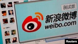 FILE - The logo of Sina Corp's Chinese microblog website 'Weibo' is seen on a screen in this photo illustration taken in Beijing.