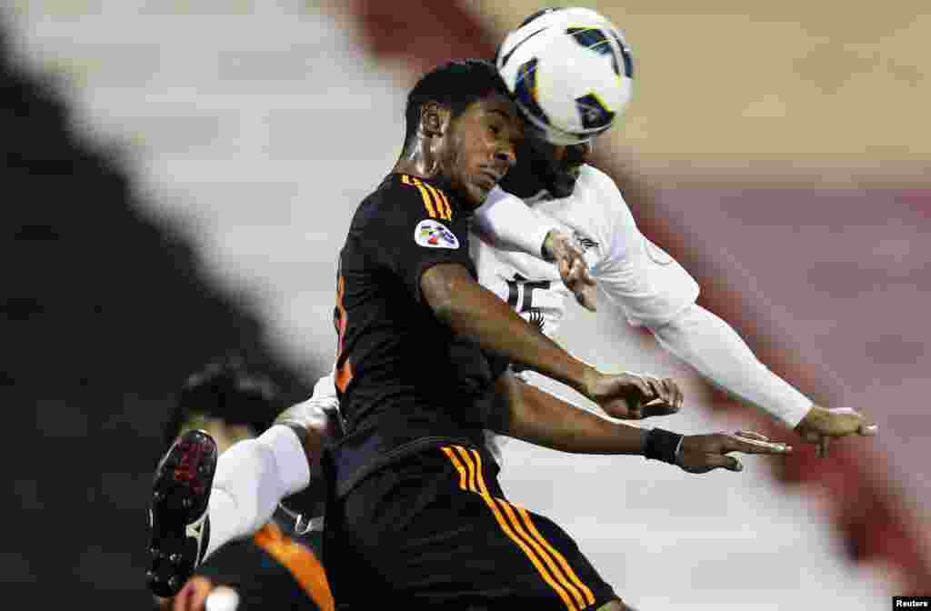Majed Mohammed (R) of Qatar's El-Jaish fights for the ball with Nasser AlShamrani of Saudi Arabia's Al-Shabab during their AFC Champions League soccer match at the Al-Rayyan Stadium in Doha, Qatar.