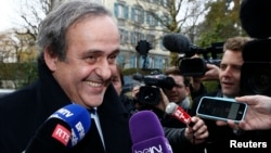 UEFA President Michel Platini smiles as he arrives for a hearing at the Court of Arbitration for Sport (CAS) in Lausanne, Switzerland, Dec. 8, 2015.