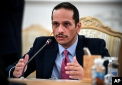 FILE - Qatar's Deputy Prime Minister and Foreign Minister Sheikh Mohammed bin Abdulrahman Al-Thani gestures as he speaks during talks in Moscow, Russia, Sept. 11, 2021.