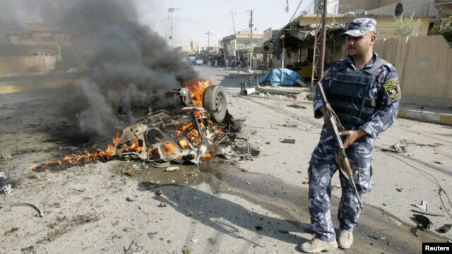 A policeman stands guard at the site of a bomb attack in Kirkuk, 250 kilometers north of Baghdad, July 23, 2012.