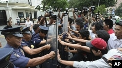 "Protesters clash with riot police and U.S. Embassy guards as the former rush towards the embassy gates to protest the joint U.S.-Philippines military exercises dubbed ""Balikatan 2011,"" which opened in Manila, Philippines, April 5, 2011."